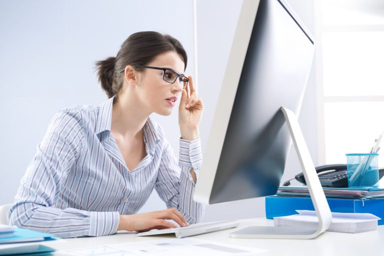 business woman staring at computer